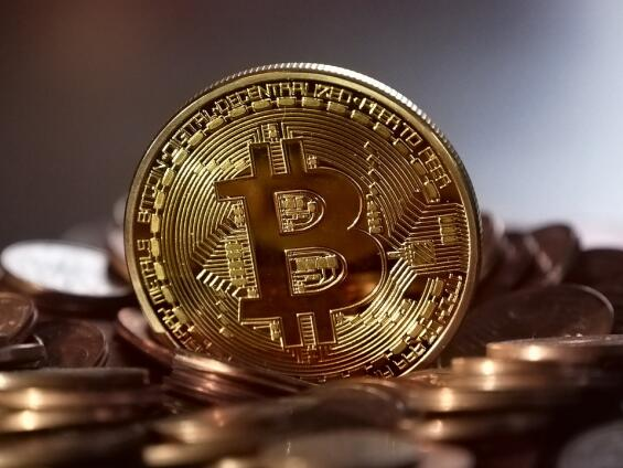 Bitcoin tumbles almost  30 per cent in volatile trading